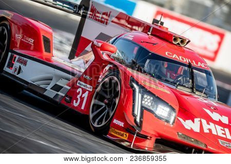 April 13, 2018 - Long Beach, California, USA:  The Whelen Engineering Racing Cadillac DPI car races through the turns at the Bubba Burger Sports Car Grand Prix At Long Beach in Long Beach, California.