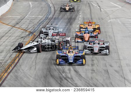 April 15, 2018 - Long Beach, California, USA: Simon Pagenaud (22) crashes off turn 1 on the first lap during Toyota Grand Prix of Long Beach race at Streets of Long Beach in Long Beach, California.