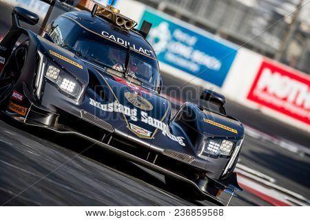 April 13, 2018 - Long Beach, California, USA:  The Mustang Sampling Racing Cadillac DPI car races through the turns at the Bubba Burger Sports Car Grand Prix in Long Beach, California.