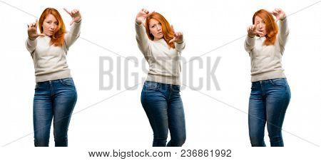 Young Beautiful redhead woman confident and happy showing hands to camera, composing and framing gesture