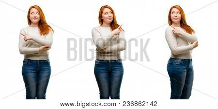 Young Beautiful redhead woman pointing away side with finger