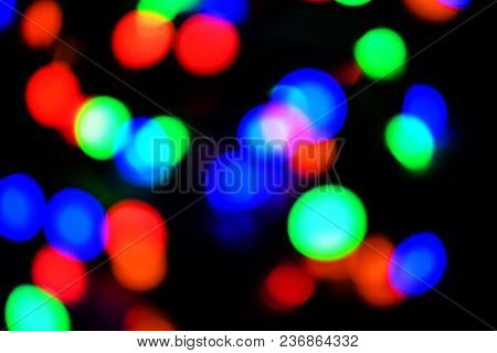 Colorful Abstract Bokeh Out Of Focus Background Of Christmas Lights On Black.