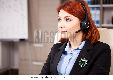 Smiling Customer Support Line Worker In Her Office