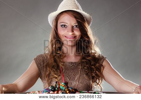 Pretty Young Mysterious Woman In Hat With Many Plentiful Of Precious Jewelry Necklaces Beads. Portra