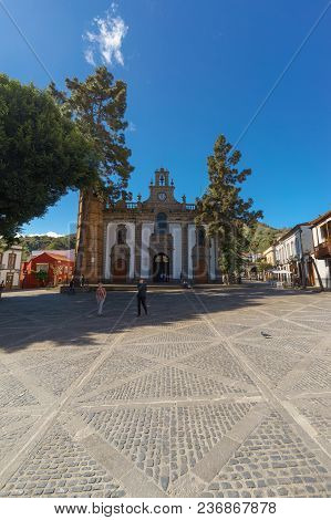 Teror, Spain - February 27, 2018: Tourists Enjoying Sunny Day On Town Square In Front Of Basilica De