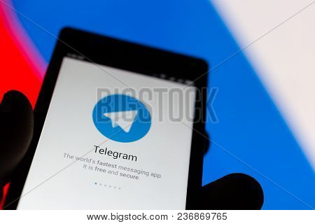 Moscow, Russia - April 17, 2018: A Mobile Phone In The Hand With The Telegram Application On The Bac