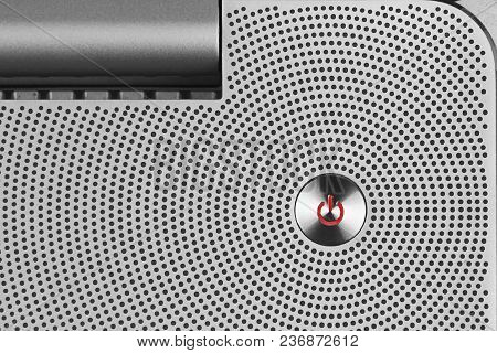 Metal Red Power Io Button On The Aluminium Perforated Surface