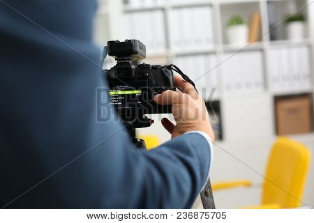 Male Arms In Suit Mount Camcorder To Tripod Making Promo Videoblog Or Photo Session In Office Closeu