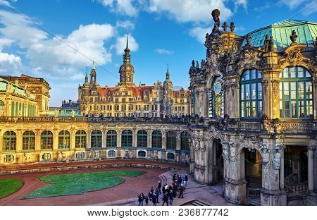 Dresden, Germany. Zwinger Palace internal yard. View to royal palace residence famous german landmark in old town of capital of Saxony region. Evening sunset with blue sky.
