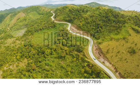 A Long And Winding Road Passing Through Green Hills. Busuanga Island. Coron. Aerial View. Philippine