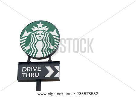 Ayutthaya, Thailand - December 26, 2017 - Starbucks Logo With Drive Thru Banner On White Sky Backgro