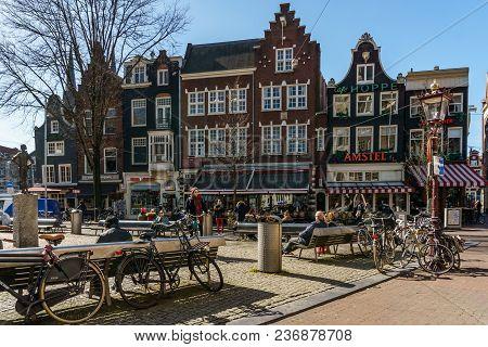 Amsterdam, Netherlands - March 20, 2018 : Square Near Amsterdams Lieverdje Statue