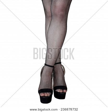 Female Legs In Stockings And High-heeled Shoes. White Isolated Background.