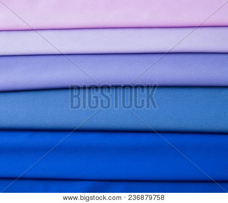 Multicolored Folds Of Blue, Blue, Lilac And Pink Fabric