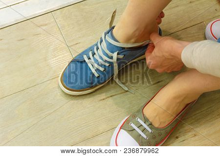 Unrecognizable Woman Trying On New Shoes, Getting Comfortable In Shop Buying And Choosing Best Footw