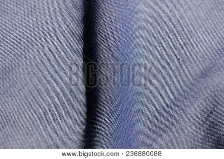 Vertical Fold On Thin Blue Jeans Fabric