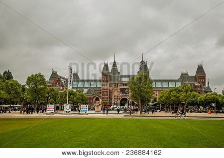 Amsterdam, Netherlands - June 24, 2017. Lawn Of Museumplein (museum Square) In Front Of The Rijksmus