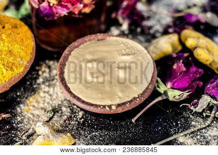 Ayurvedic Ubtan Of Haldi With Holy Rose Water And Fuller's Earth On Wooden Surface For Good, Brighte
