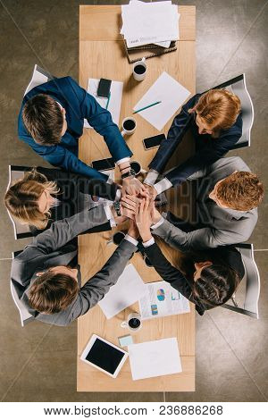 Overhead View Of Business Partners At Table In Office, Businesspeople Teamwork Collaboration Relatio
