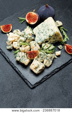 Slice Of French Roquefort Cheese With Figs On Stone Serving Board