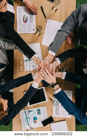 Cropped View Of Business Partners At Table In Office, Businesspeople Teamwork Collaboration Relation