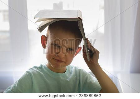 Boy Holding A Book Over Your Head, Do Not Want To Read