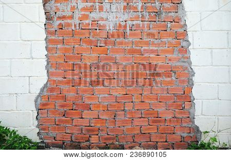 The Wall Made Of Red And White Brick.