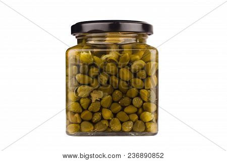 Front View Closeup Of Jar With Capers In Vinegar And Black Cap Isolated On White Background With No