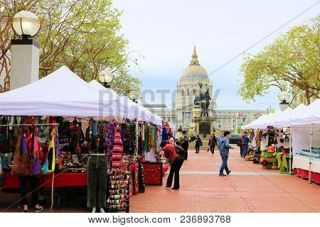 April 3, 2018 In San Francisco, Ca:  People Shopping At Tents With Merchandise For Sale Taken At The