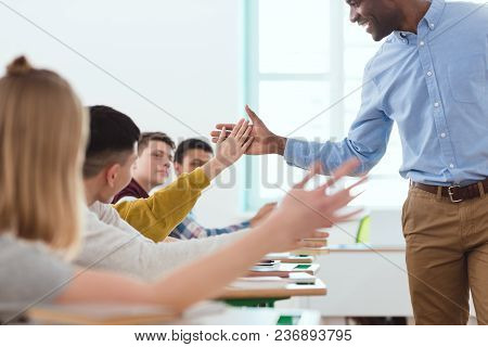 Cropped Image Of African American Taking High Five To Multicultural High School Teenage Students