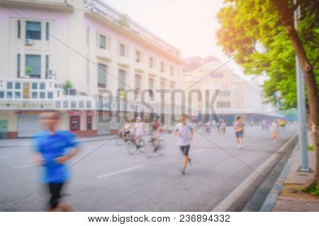Blurred Image Of Vietnamese Exercise In The Morning Around The Lake In Hanoi Capital City, Vietnam.