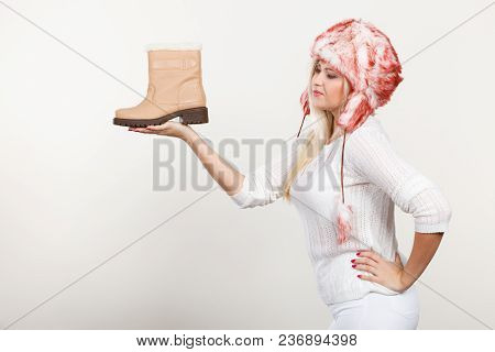 Shoes For Cold Days Ideas, Fashion, Clothes Concept. Woman In Furry Winter Hat Holding Warm, Beige B