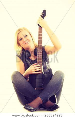 Music Concert And Show. Blonde Pretty Woman Artist Playing Rock Roll On Electrical Guitar. Young Gir