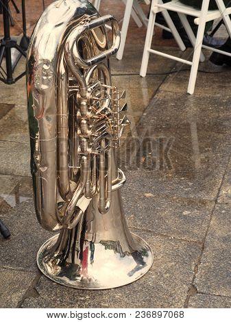 Tuba On The Paving Blocks In The Rain