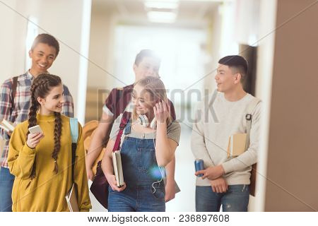 Group Of High School Classmates Spending Time At School Corridor Together