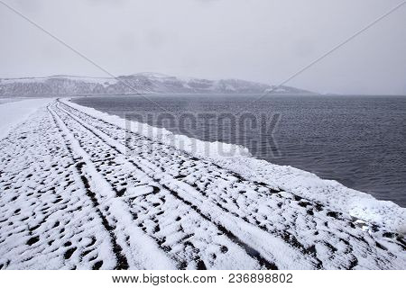 The Snowy Shore Line Of Lake Kleifarvatn On The Reykjanes Peninsula