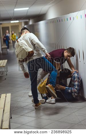 African American Schoolboy Being Bullied In School Corridor