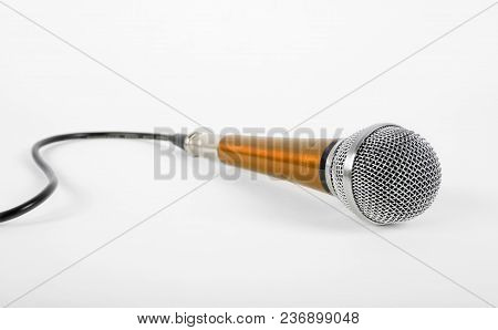 Music And Sound - Vintage Orange Vocal Microphone On A White Background.