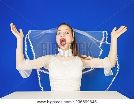 Pretty Jung Funny Bride In White Fop Spread Her Arms On Both Sides Of The Excitement And Anticipatio