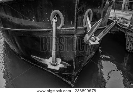Close-up Of Prow And Rusty Anchor Of A Boat Moored In Port At Amsterdam. Famous For Its Huge Cultura