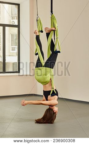Sporty Woman Doing Fly Yoga Asana Being Upside Down
