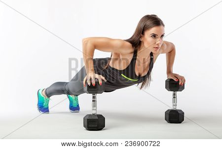 Strong Young Woman Doing Push-ups. Fit Female Exercising In Health Club