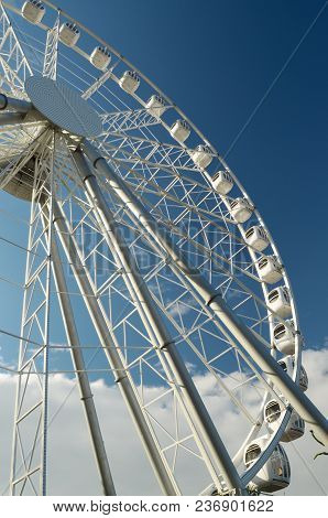 A Fragment Of The Attraction,the Ferris Wheel On The Background Of Blue Sky.