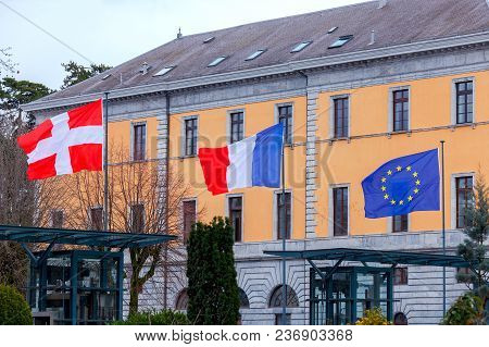 Swiss, French And The Flag Of The European Union In Front Of The City Hall Of Annecy. France.