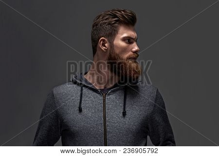 Image Of Single Standing In Profile Young Handsome Serious Bearded Man In Black Hoodie Over Black Ba