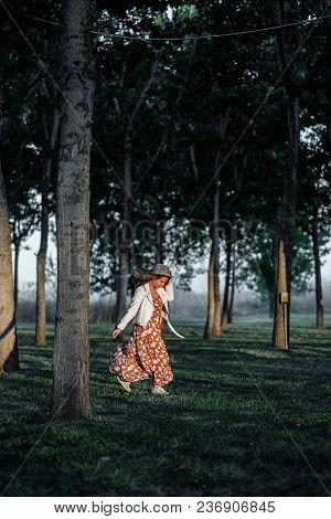 Beautiful Girl In A  Dress Walking In  The Woods