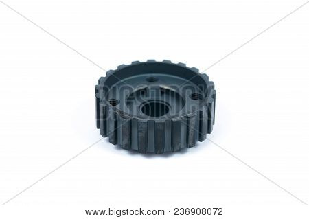Close-up Of A Crankshaft Gear On An Isolated White Background. New Spare Parts.