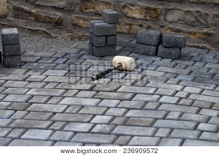 Interlocking Paving With Gray And White Concrete Blocks; Concrete Products; Construction Industry.