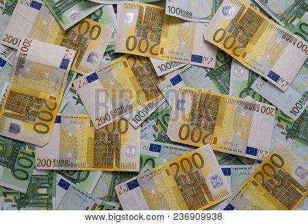 Scattered 200 Euro, 100 Euro Banknotes, European Currency - Background.