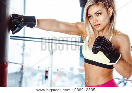Sexy Fighter Girl Punching Actively. Motion Long Hair